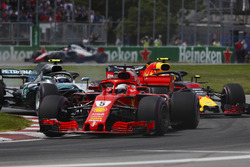 Sebastian Vettel, Ferrari SF71H, leads Valtteri Bottas, Mercedes AMG F1 W09 and Max Verstappen, Red