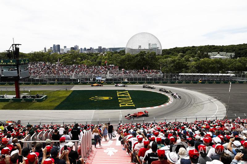 Kimi Raikkonen, Ferrari SF71H, leads Esteban Ocon, Force India VJM11, and Nico Hulkenberg, Renault Sport F1 Team R.S. 18