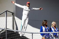 Race winner Lewis Hamilton, Mercedes AMG F1, jumps as he celebrates on the podium