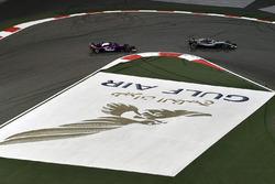 Lewis Hamilton, Mercedes-AMG F1 W09 EQ Power+ and Pierre Gasly, Scuderia Toro Rosso STR13