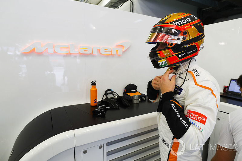 Stoffel Vandoorne, McLaren, adjusts his helmet strap