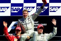 Podium: second place Michael Schumacher, Ferrari, Race winner Mika Hakkinen, McLaren, third place Da