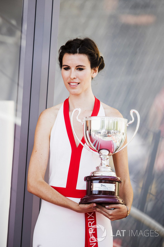 Grid girls with the trophies