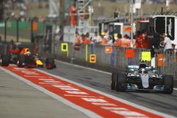 Valtteri Bottas, Mercedes AMG F1 W08, leads Daniel Ricciardo, Red Bull Racing RB13, out of the pit lane