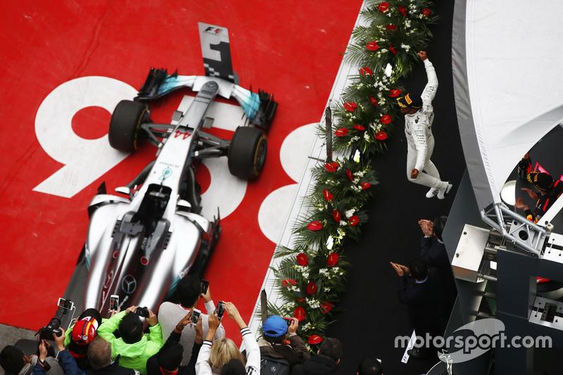 Lewis Hamilton, Mercedes AMG, celebrates victory on the podium with Max Verstappen, Red Bull Racing RB13 and Sebastian Vettel, Ferrari SF70H