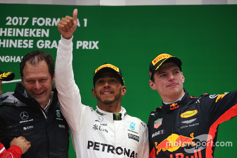 Aldo Costa, Engineering Director, Mercedes AMG, Lewis Hamilton, Mercedes AMG, and Max Verstappen, Red Bull Racing, on the podium