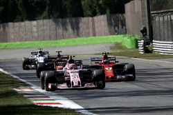 Kimi Raikkonen, Ferrari SF70H battles for position, Esteban Ocon, Sahara Force India VJM10