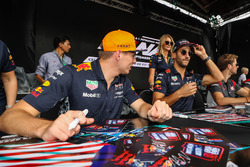 Max Verstappen, Red Bull Racing and Daniel Ricciardo, Red Bull Racing sign autographs for the fans