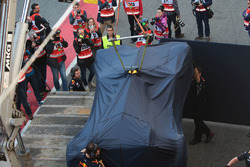 The Red Bull Racing RB13 of Daniel Ricciardo back to the pits