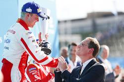 Felix Rosenqvist, Mahindra Racing, receives his trophy on the podium