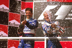 Podium: race winner Jacques Villeneuve, Williams Renault, second place Damon Hill, Arrows