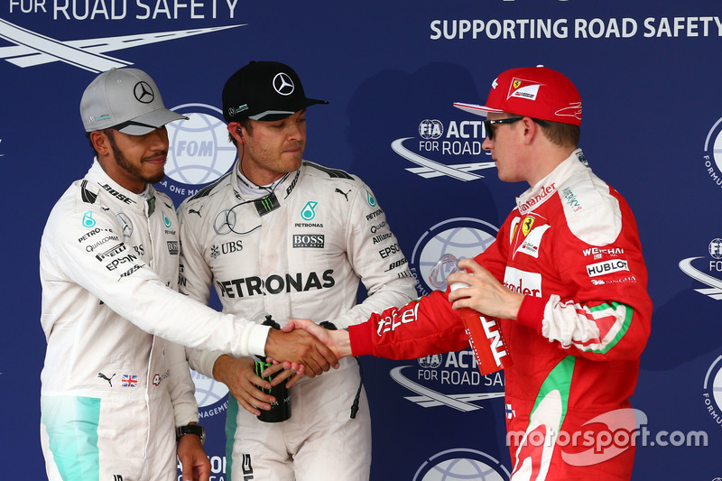 Qualifying top three in parc ferme (L to R): second place Lewis Hamilton, Mercedes AMG F1; Polesitter Nico Rosberg, Mercedes AMG F1; third position Kimi Raikkonen, Ferrari