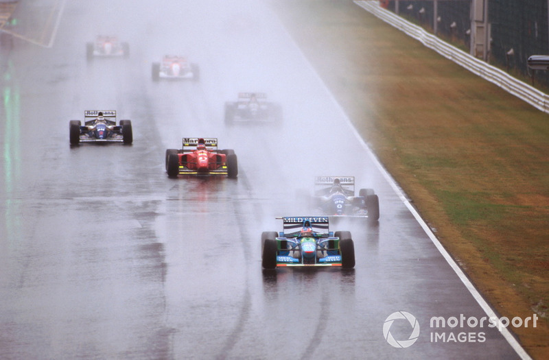 Michael Schumacher, Benetton B194 Ford leads the field