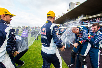 Race winners Jamie Whincup, Paul Dumbrell, Triple Eight Race Engineering Holden celebrate with champagne