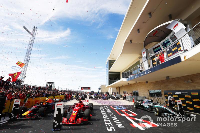 Kimi Raikkonen, Ferrari SF71H, festeggia sul podio con Max Verstappen, Red Bull Racing, e Lewis Hamilton, Mercedes AMG F1 W09 EQ Power+, dopo aver vinto la gara
