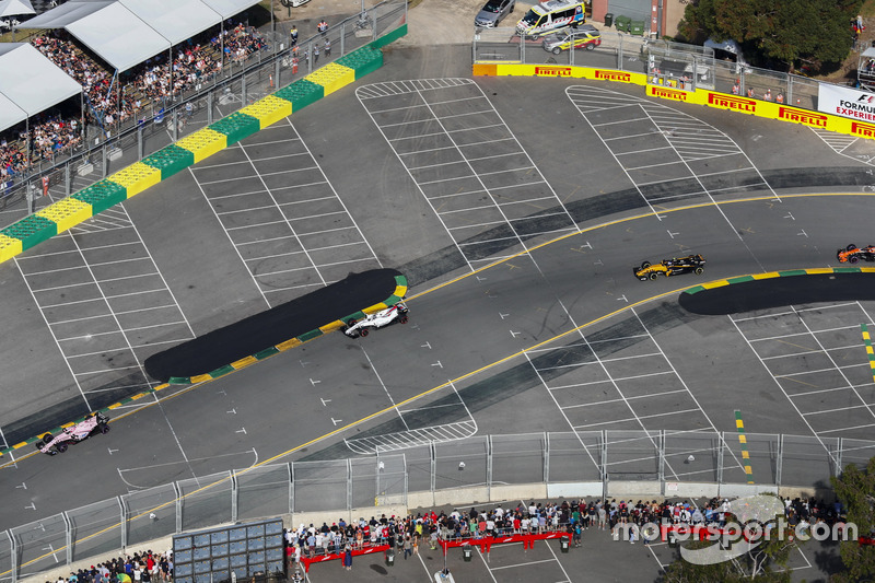 Esteban Ocon, Force India VJM10, leads Lance Stroll, Williams FW40, and Jolyon Palmer, Renault Sport F1 Team RS17