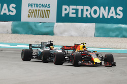 Max Verstappen, Red Bull Racing RB13, passes Lewis Hamilton, Mercedes AMG F1 W08 for the lead