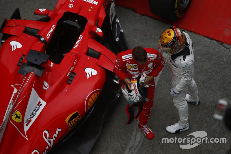 Lewis Hamilton, Mercedes AMG, and Sebastian Vettel, Ferrari, celebrate in parc ferme