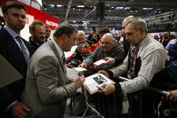 Nigel Mansell signs autographs for fans