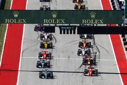 Lewis Hamilton, Mercedes AMG F1 W08, Sebastian Vettel, Ferrari SF70H, lead at the start of the race