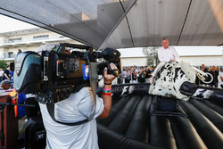 Sean Bratches, Managing Director of Commercial Operations, Formula One Group, tries his hand at the mechanical rodeo bull