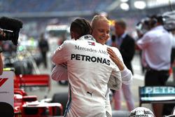 Lewis Hamilton, Mercedes AMG F1, celebrates victory in parc ferme, with Valtteri Bottas, Mercedes AMG F1