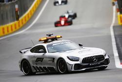 The Safety Car leads Sebastian Vettel, Ferrari SF71H, and Lewis Hamilton, Mercedes AMG F1 W09