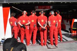 Ferrari mechanics cover the garage