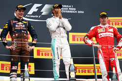 Race winner Lewis Hamilton, Mercedes AMG F1 celebrates on the podium with second place Max Verstappe