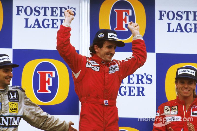 Podium: race winner Alain Prost, McLaren TAG Porsche, second place Nelson Piquet, Williams Honda, th