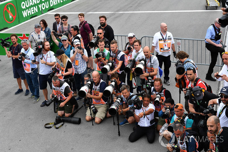 Photographers waiting in parc ferme