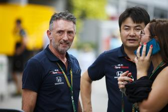 Toro Rosso Honda team members converse in the paddock