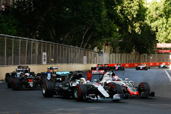Lewis Hamilton, Mercedes AMG F1 W07 Hybrid and Romain Grosjean, Haas F1 Team VF-16 battle for positi