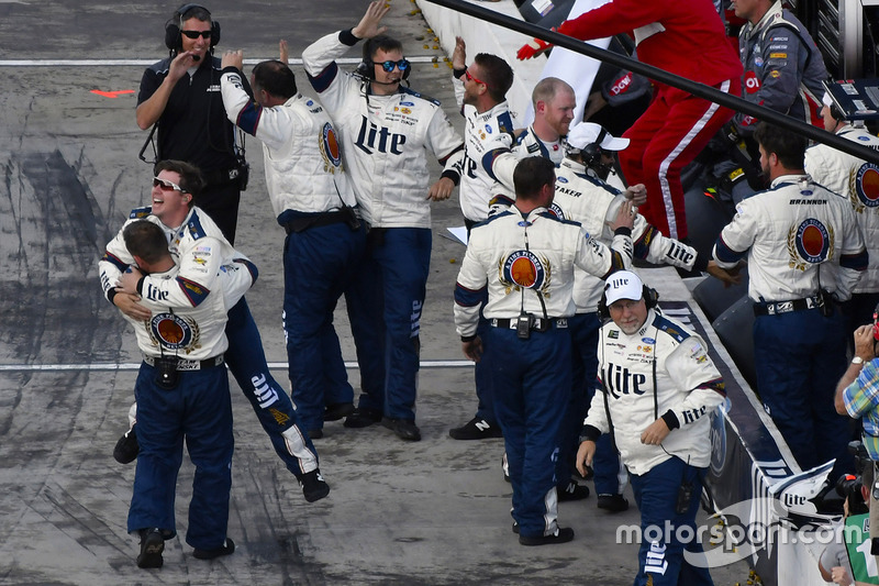 Team Penske crew members celebrate the win