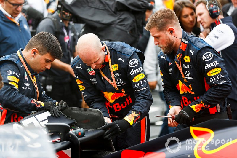 Red Bull mechanics at work on the grid