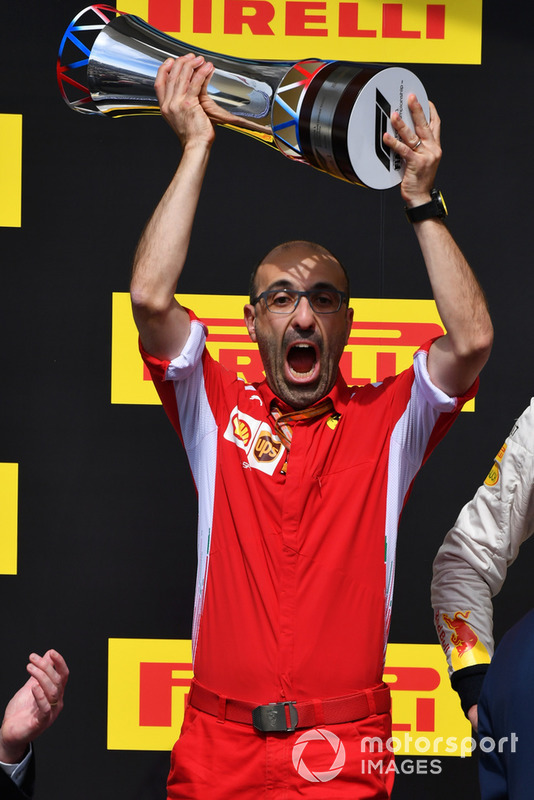Carlo Santi, Ferrari Race Engineer celebrates on the podium with the trophy