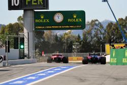 Carlos Sainz Jr., Scuderia Toro Rosso STR12 Y Kimi Raikkonen, Ferrari SF70H