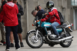 Sebastian Vettel, Ferrari arrives on a Suzuki 750 motor bike
