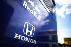 Red Bull and Honda badges on the side of the Toro Rosso team truck