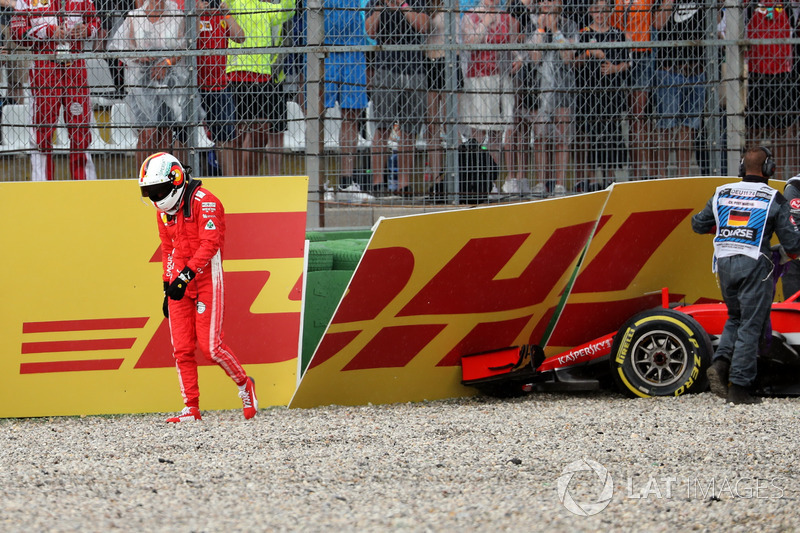 Sebastian Vettel, Ferrari SF71H walks in after crashing out of the race