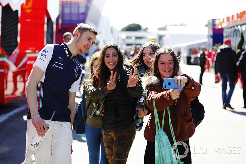 Sergey Sirotkin, Williams FW41, is wheeled into his garage by mechanics