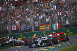Lewis Hamilton, Mercedes AMG F1 W09, leads Kimi Raikkonen, Ferrari SF71H, Sebastian Vettel, Ferrari SF71H, Kevin Magnussen, Haas F1 Team VF-18 Ferrari, Max Verstappen, Red Bull Racing RB14 Tag Heuer, and the rest of the field at the start
