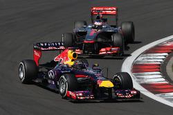 Sebastian Vettel, Red Bull Racing RB9 leads Jenson Button, McLaren MP4-28