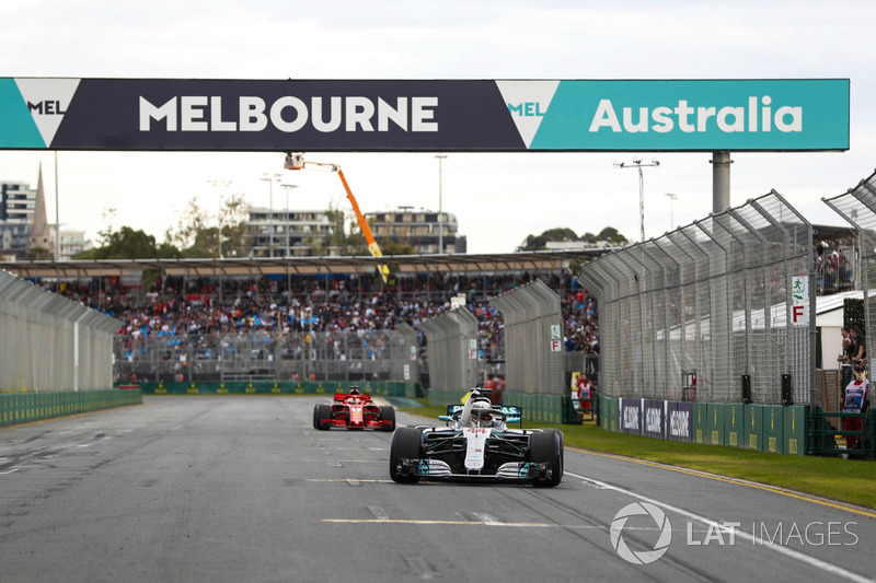 Lewis Hamilton, Mercedes AMG F1 W09, celebrates taking pole position on the pit straight