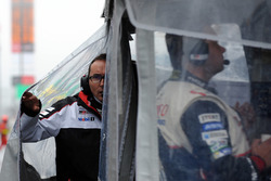 Toyota Racing team members check the weather