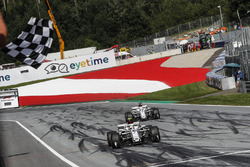 Charles Leclerc, Sauber C37 and Marcus Ericsson, Sauber C37 take the chequered flag