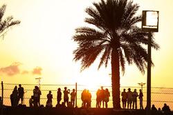 Fans enjoy the sun set