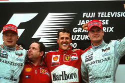Podium: Mika Hakkinen second , Jean Todt, race winner Michael Schumacher, Ferrari F1 2000 and David