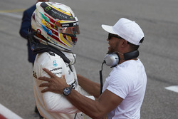Lewis Hamilton, Mercedes AMG F1, celebrates with his brother Nicolas Hamilton, after securing pole p