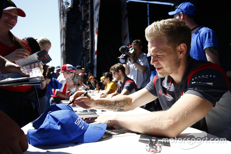 Kevin Magnussen, Haas F1 Team, signs autographs alongside Romain Grosjean, Haas F1 Team